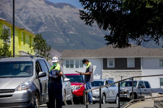 Packed Minivans Line Up for Covid Tests as Children Fall Sick
