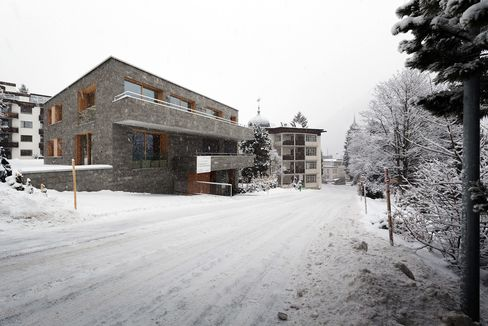 Snow sits on the ground outside a residential apartment in the Mountain Rock building in Davos, Switzerland, on Tuesday, Jan. 12, 2015.