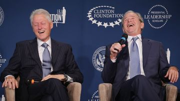 Former U.S. presidents Bill Clinton (L) and George W. Bush share a laugh during an event launching the Presidential Leadership Scholars program at the Newseum September 8, 2014 in Washington, DC.