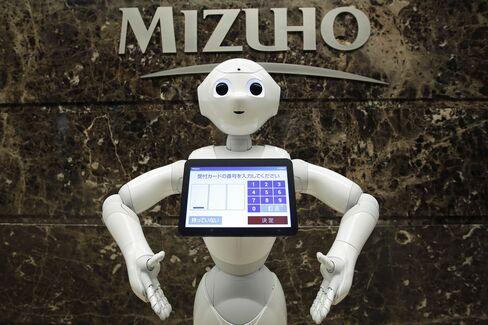 SoftBank Group Corp.'s Pepper Robot Starts Work At A Mizuho Bank Branch