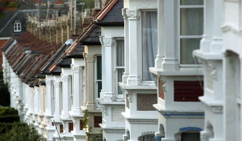 A Row of Houses Stand in London