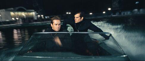 Kuryakin and Solo dodge bullets in a 75-horsepower Fletcher powerboat.