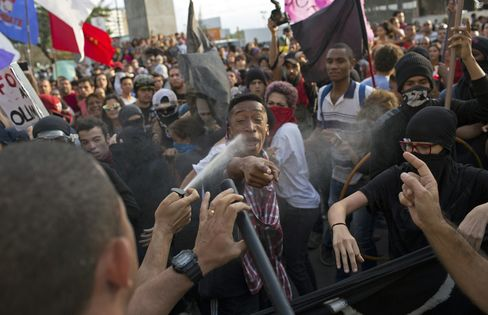 Police pepper spray protesters on the torch route, in Niteroi, on Aug. 2.