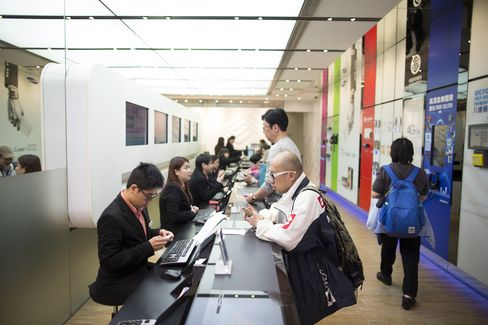 Employees Serve Customers at a China Mobile Ltd. Store