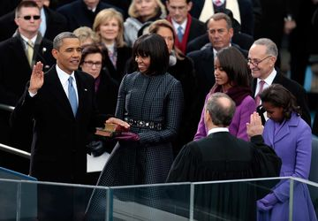 U.S. President Barack Obama, left, takes the oath of office from Supreme Court Chief Justice John Roberts, right, as first lady Michelle Obama holds the Lincoln Bible and the traveling bible of slain civil rights leader Martin Luther King Jr. during the ceremonial swearing-in at the presidential inauguration in Washington, D.C., U.S., on Monday, Jan. 21, 2013. As he enters his second term Obama has shed the aura of a hopeful consensus builder determined to break partisan gridlock and adopted a more confrontational stance with Republicans.