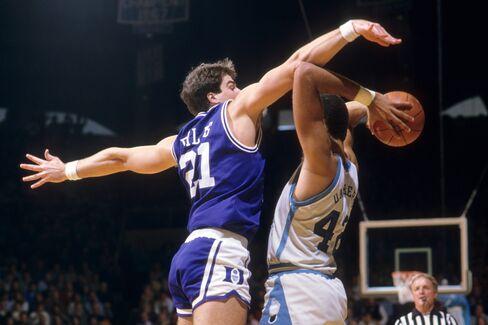 North Carolina's Brad Daugherty (42) in action vs. Duke's Jay Bilas (21) at Carmichael Arena in Chapel Hill, N.C., in 1985