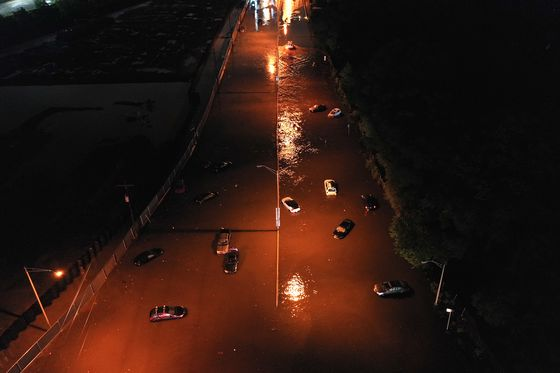 Urban Rowboat Rescues and Chest-Deep Water: Scenes of the Flood
