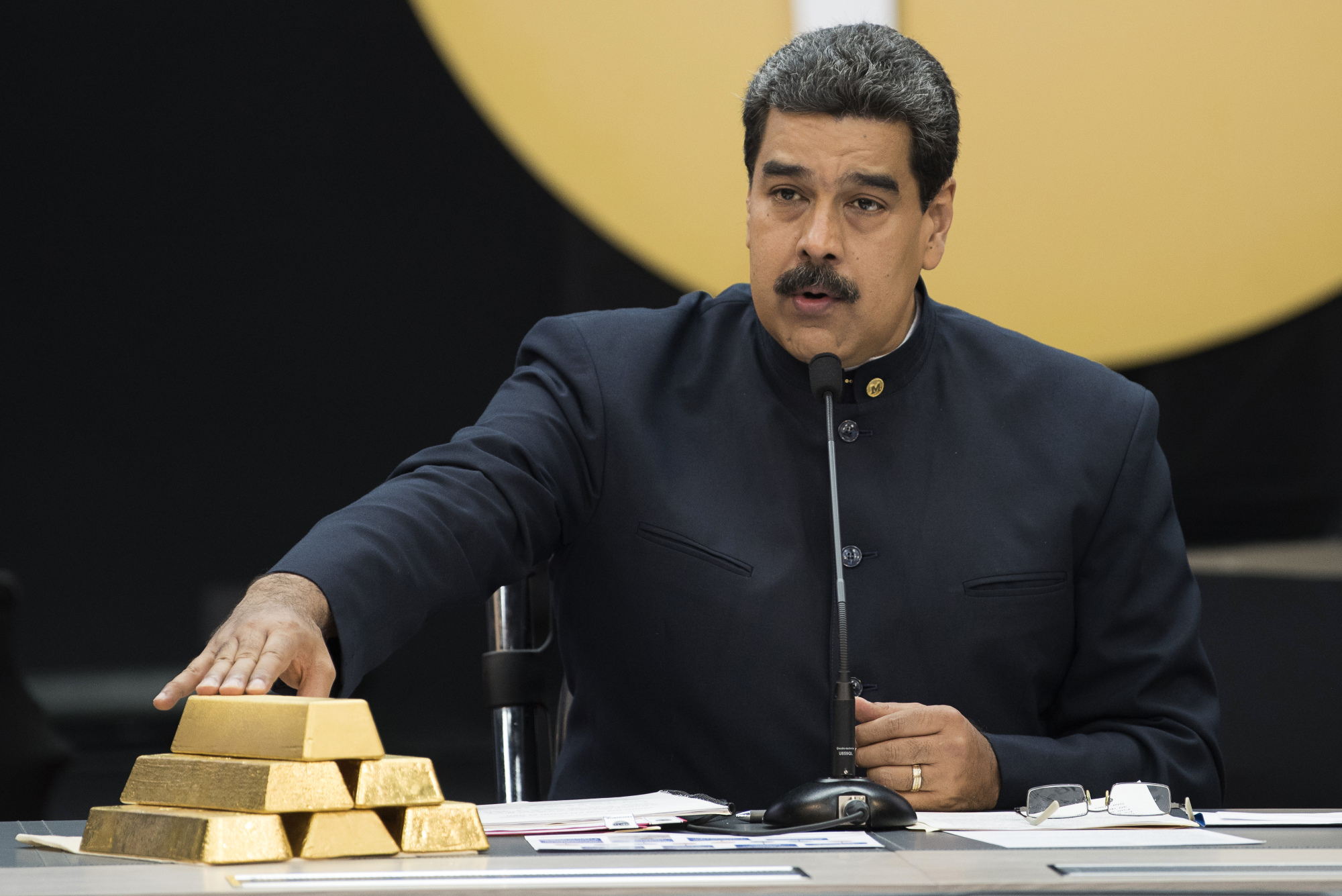 Maduro speaks as he touches a stack of 12 Kilogram gold ingots in Caracas.