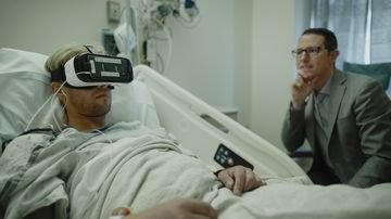 Dr. Brennan M. Spiegel observes a patient using a VR headset