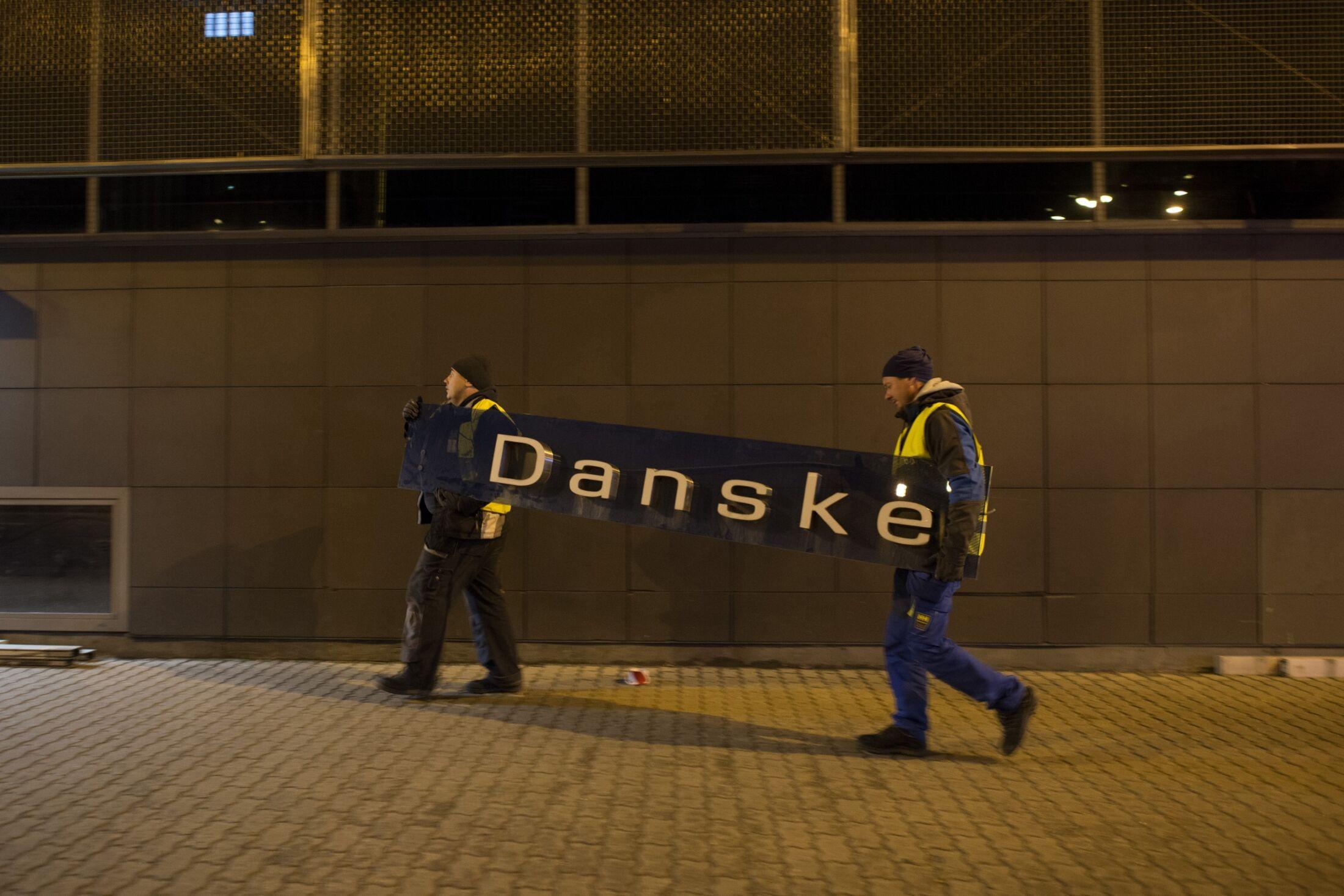 Workers remove Danske Bank signage in Estonia