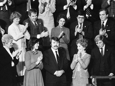 Lennie Skutnik, center front, the man who jumped into the Potomac River and saved one of the passengers aboard the Air Florida jetliner that crashed on Jan. 13, receives applause from first lady Nancy Reagan and his wife, second from left, in the House chamber on Capitol Hill in Washington on Jan. 27, 1982.