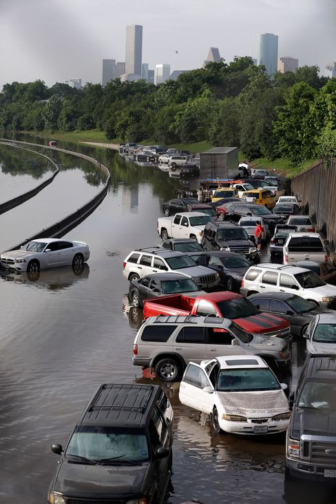 Cars remain stranded along a flooded section of Interstate 45 after heavy rains overnight in Houston, Tuesday, May 26, 2015. Several major highways are closed in the Houston area due to high water.