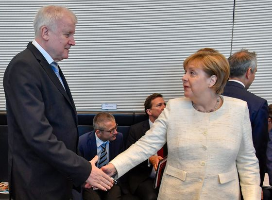 Merkel Averts German Coalition Crisis With Migration Deal