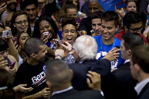 Senator Bernie Sanders greets attendees at a campaign rally in Tampa.