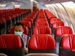 An official sits alone inside an aircraft before leaving Jakarta airport in Tangerang on February 1, 2020, in order to carry Indonesians back home from Wuhan, China.