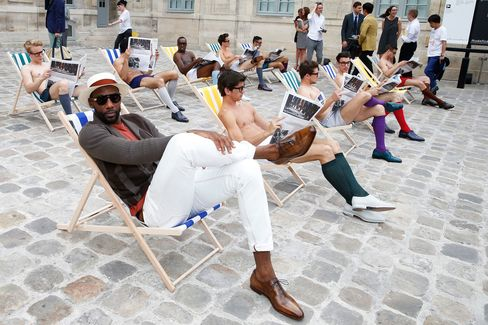 Stoudemire pals around with the lounging models before the Berluti show, in a pair of the brand's iconic, handmade shoes, at the Musée Picasso.