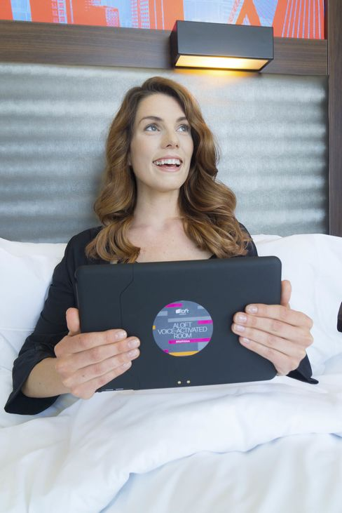 An Aloft guest teaches Siri to recognize her voice via the in-room iPad.