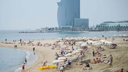 Visitors sunbathe at La Marbella beach in Barcelona.