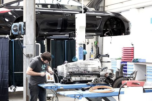 A Kreisel Electric engineer works on a electric Porsche Panamera drivetrain.