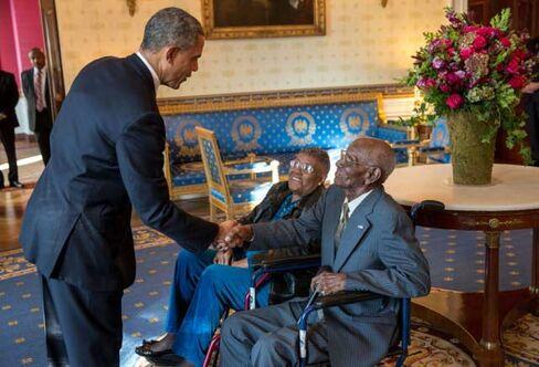 President Barack Obama greets Richard Overton in the Blue Room of the White House, Nov. 11, 2013.
