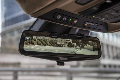 Flip a switch on the rearview mirror and it will become a camera.