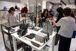 Customers look at bags for sale at the Isetan Shinjuku department store, operated by Isetan Mitsukoshi Holdings Ltd., in Tokyo, Japan.