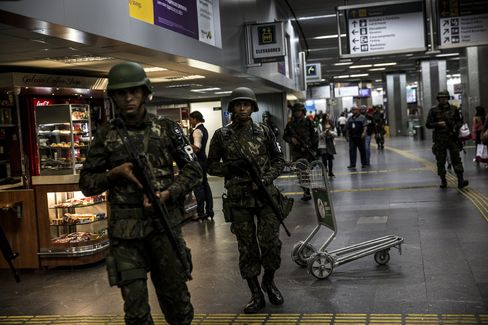 Military soldiers patrol inside Galeao International Airport on July 20.