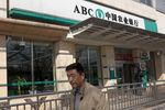 A man walks past an Agricultural Bank of China Ltd. branch in Beijing, China.