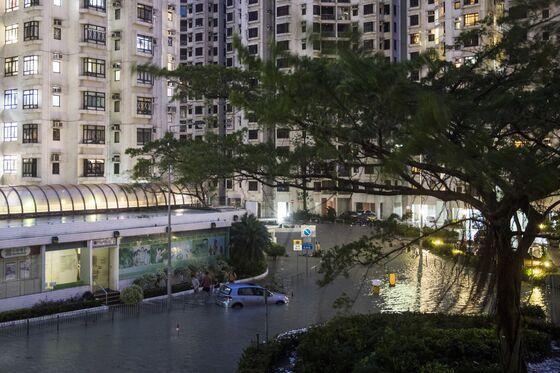Flights Resume as Typhoon Moves on After Battering Hong Kong
