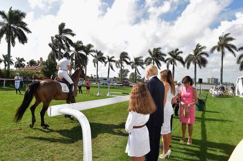 Donald and Melania Trump at the Trump Invitational Grand Prix Mar-a-Lago Club at The Mar-a-Largo Club on Jan.4, 2015 in Palm Beach, Florida.