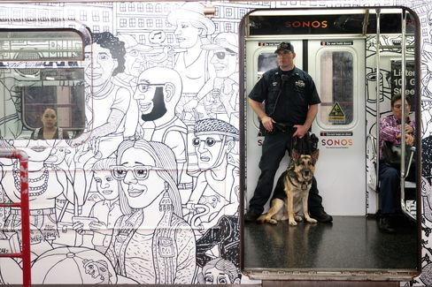 Police patrol a subway train.