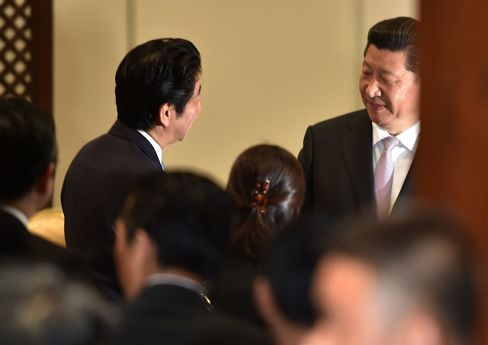 Chinese President Jinping And Japanese Prime Minister Abe