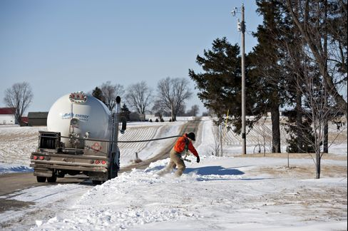 A Liquid Fuels Technician Delivers Propane in the Snow