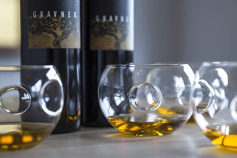 An orange wine from Italy's Gravner, which ages the juice in beeswax-lined clay amphorae buried underground.