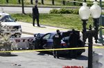 U.S. Capitol Police officers stand near a car that crashed into a barrier on Capitol Hill in Washington, on April 2.