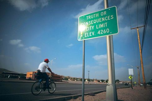 A man cycling into the town of Truth or Consequences, N.M.