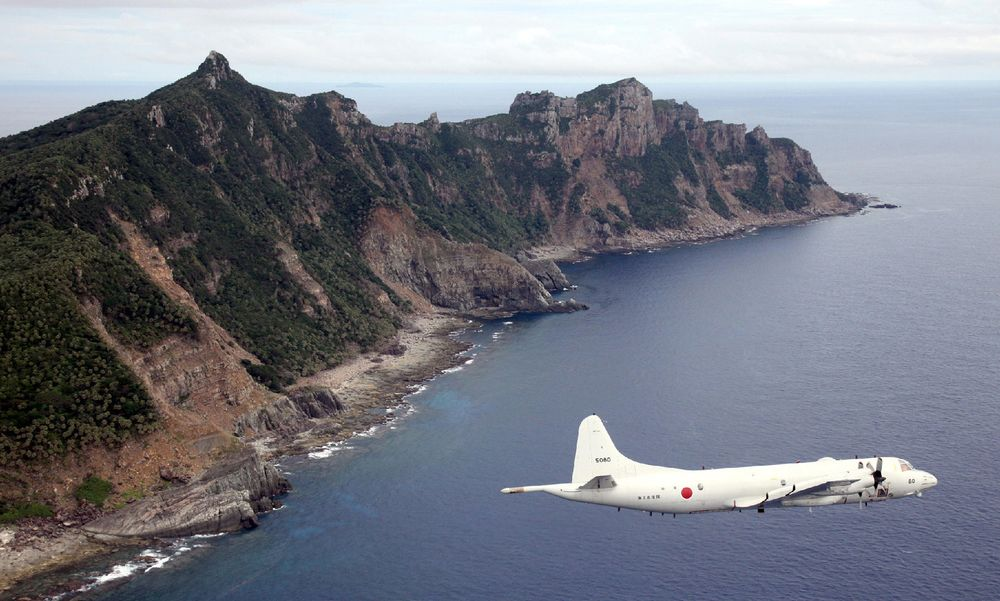 A P-3C patrol plane of Japanese Maritime Self-Defense Force flies over the disputed islets known as the Senkaku islands in Japan and Diaoyu islands in China, in 2011.