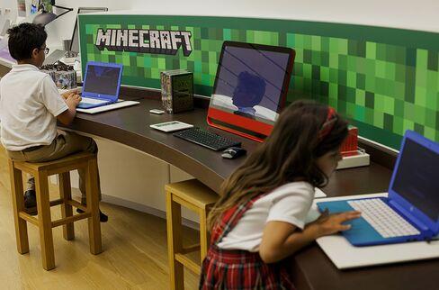 Children play the Minecraft video game at a Microsoft store in Bellevue, Washington, U.S.