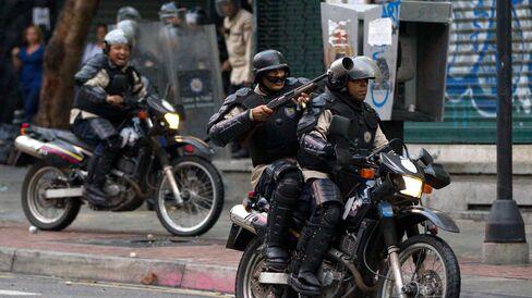 Police fire rubber bullets at opposition demonstrators in Caracas, Venezuela, on Feb. 12, 2015.