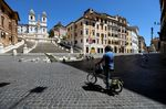 A cyclist stops near the Spanish Steps in Rome on May 4.