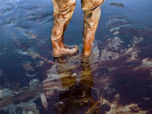 A photographer's oil covered waders on Grand Terre Island, Louisiana following the BP oil spill.