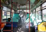 A worker wearing a protective suit sprays disinfectant inside a bus at a depot in the Eunpyeong district of Seoul, South Korea, on Feb. 24, 2020.