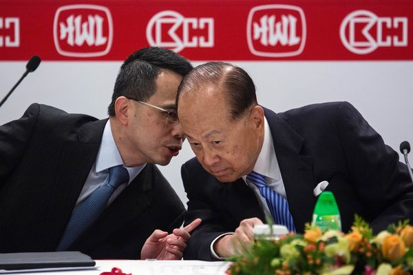 Image result for Li Ka-shing and Victor Li during a news conference in Hong Kong.  Photographer: Lam Yik Fei/Bloomberg