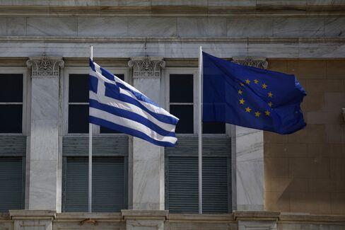 A Greek National Flag Flies Beside a EU Flag in Athens