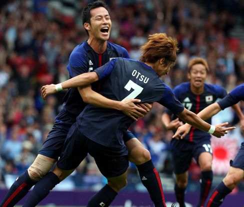 Japan Upsets Spain 1-0 in Olympic Soccer Match as Uruguay Wins