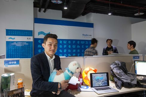 Raybo founder Justin Sun holds a toy alpaca, a symbol of opposition to Internet censorship.