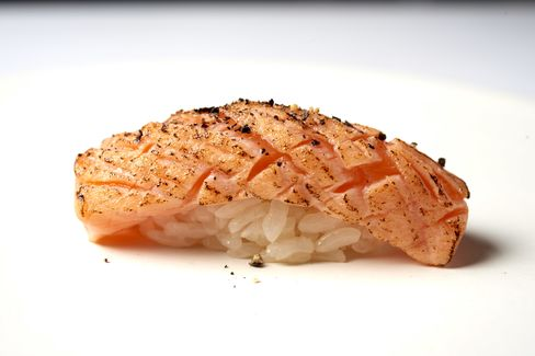 A piece of king salmon from Tasmania, scored and lightly torched for maximum flavor.