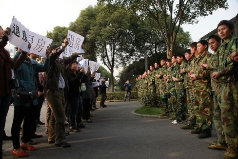 Property Buyers Protest Opposite Security Guards