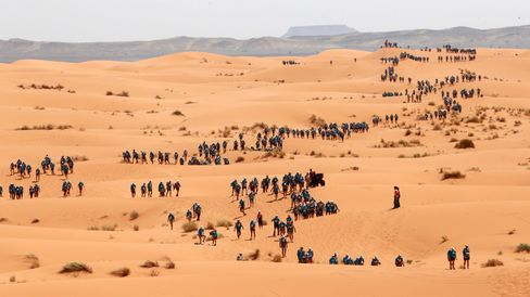Participants cross the dunes of Merzouga during the last stage of the 28th Marathon des Sables, on April 13, 2013.