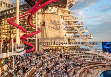 The ship is gargantuan. The AquaTheater on the stern of the ship, an amphitheater-style entertainment space, showcases professional aquatic acrobatic and synchronized swimming performances and goes off at night with water and light shows. That climbing wall is 43-feet high (and there are two).